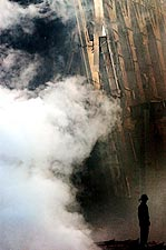 Fire Fighter with Rubble and Smoke 9/11 NYC Photo Print for Sale