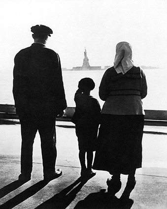 Immigrants at Battery Park Look Toward Statue of Liberty Photo Print
