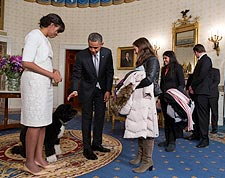 Obamas and 'Bo' Greet White House Visitors Photo Print for Sale