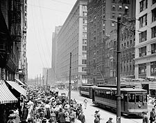 Pedestrians and Streetcars on State Street in Chicago Photo Print for Sale