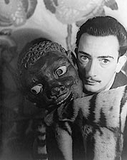 Salvador Dal� with Carved Mask 1939 Photo Print for Sale