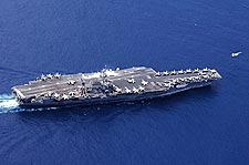 USS Kitty Hawk with F/A-18 Hornet Taking Off Photo Print for Sale