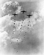 WWII Aircraft Dropping Parachutes & Men Photo Print for Sale