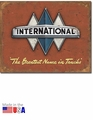 """International - The Greatest Name in Trucks\"" Tin Sign"