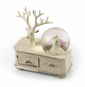 Ivory Wedding Couple Musical Snow Globe atop of a Silver Accented Commode