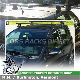 2005 Scion xA Roof Rack Cross Rails using Thule 480 Traverse Car Rack (w/ 480 Foot Pack, 1268 Traverse Fit Kit Clips, LB50 Load Bars)