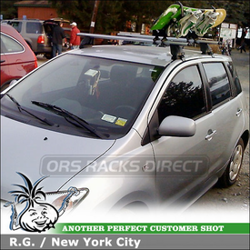 2005 Scion xA Snowboard Rack using Thule 575 Universal Snowboard Carrier