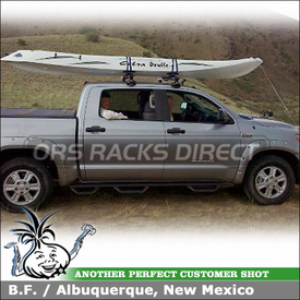 2011 Toyota Tundra Crew Max Roof Rack Kayak Saddles using Thule 881 Top Deck, 480R Foot Pack, 1555 Fit Kit and AeroBlade Crossbars
