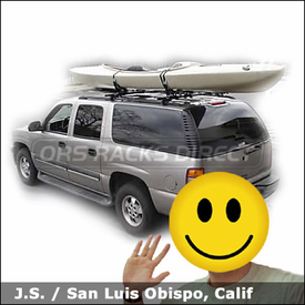 Chevrolet Suburban with Yakima Lowrider Roof Rack and Yakima Mako Saddles-HullyRoller Kayak Rack