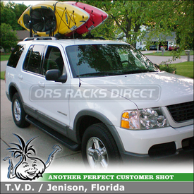 Factory Rack Cross Bars Kayak Carriers on a 2002 Ford Explorer