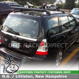 Kayak Saddles and Kayak Roller Lift-Assist for 2006 Subaru Forester Factory Rack Crossbars using Yakima ShowBoat 66 Roller & Mako Aero Saddles