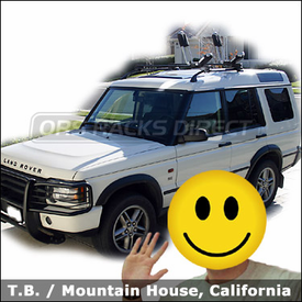 Land Rover Kayak Roof Rack with Thule 450 Crossroad Base Rack System and Thule 835XTR Kayak Rack