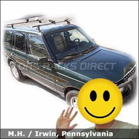 Land Rover RangeRover with Thule 4304 Range Rover Roof Rack and Thule 883 Glide & Set Kayak Rack