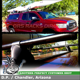 Leer Truck Cap Tracks with Roof Rack Cross Bars for a Canoe on a 2010 Toyota Tundra