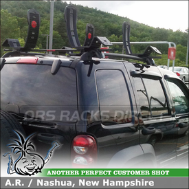 Roof Rack Cross Bars and 2 Kayak Racks for Jeep Liberty Side Rails using Malone MPG202 Universal Cross Rails & AutoLoader J-Cradles