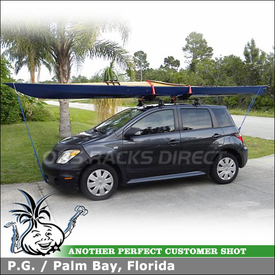 Roof Rack Crossbars and Kayak Saddles for 2006 Scion xA using Inno IN-SU Car Rack (w/ Stays, K234 Hooks, B117 Bars) and Malone SeaWing Kayak Rack