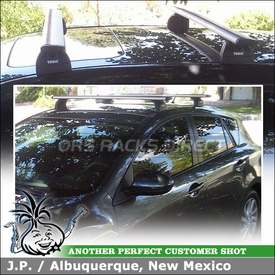 Roof Rack for 2012 Mazda 3 Fixed-Points using Thule 460R Rapid Podium Foot Pack, 3069 Fit Kit & ARB47 AeroBlade Load Bars
