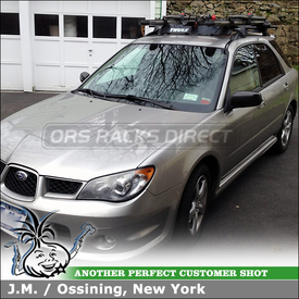 Yakima High Roller and Raptor Bike Racks Mounted to 2006 Subaru Impreza Rail Grab Towers Factory Side Rails Car Rack Crossbars