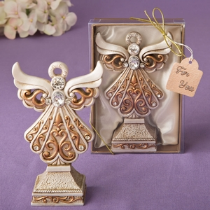 Antique ivory angel statue with a matte gold filigree detailing from fashioncraft