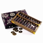 Abacus with Coins in Slik Box
