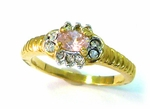 gold ribbed pink oval cubic zirconia ring