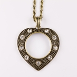 Necklace antiqued gold heart with crystal accents magnifying glass