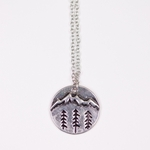 necklace antiqued silver round pendant trees and mountains