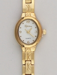 Watch gold oval white face with diamond cut gold band