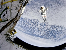 Flying Astronaut over Earth