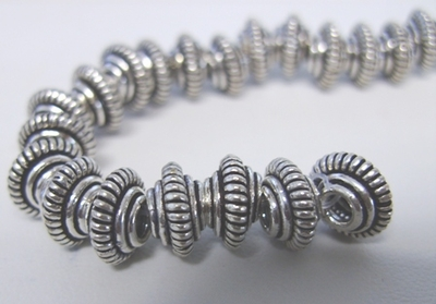 Coil Bi-Cone - 10mm - 34 Beads - .999 Pure Silver Over Copper<br>SCBK07-10