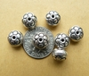 7 Sterling Silver 6x8mm flattened round Bead with flower design