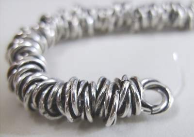 Twisted Rings - 8mm - Approx. 115 Rings - .999 Silver Over Copper<br>SCBK28
