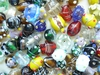 Assortment of 15 Hand crafted Glass focal beads random sizes 10 to 15mm