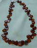 "Baltic Amber freeform beads cherry color 16"" strands side drilled"