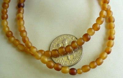 "Bone horn beads 4mm barrel 16"" strands Amber color"