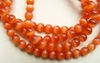 "Cats Eye Orange Beads 4 or 6mm round 16"" strands"