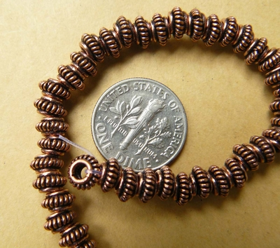 """Copper 4x6mm crown bead over 60 beads 8"""" strand"""