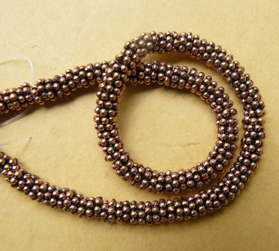 Copper Daisy spacer 5mm over 120 beads