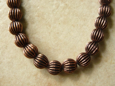 Copper round Grooved 10mm antiqued beads 19 beads