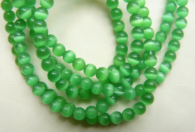 "Fiber Optic Green Cats Eye Beads 16"" Strands"