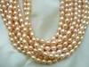 "Peach Fresh Water Pearl A grade 7x8mm 16"" strands"