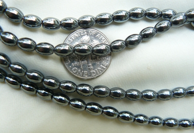 "Hematite Beads fat Rice Shape and size 16"" strands"