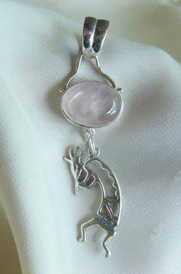 Kokopelli Pendant with Rose Quartz Set in sterling silver 12x16mm stone