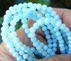 "Round 4mm powder blue shell beads 16"" strands"