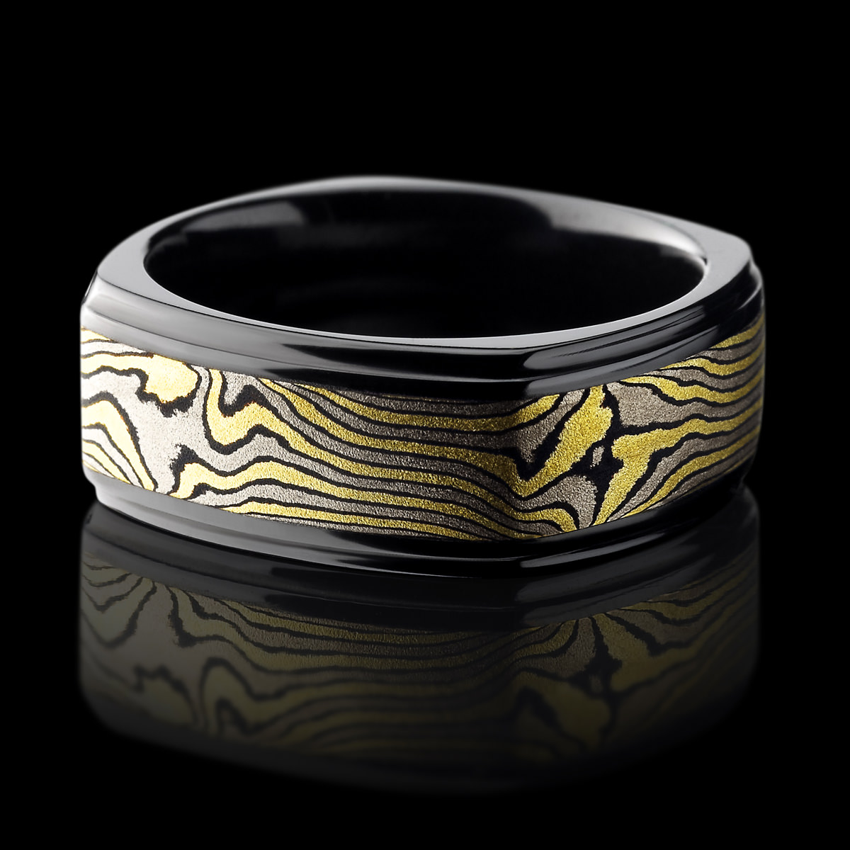 custom products titanium mokume rings gold rose gane and anodized sleeve ring made with damascus