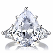 Carmelita's Pear Cut 3 Stone Ring - 8 CT Center Stone