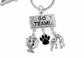 "<Br>                EXCLUSIVELY OURS!! <Br>           AN ALLAN ROBIN DESIGN!! <Br>              LEAD & NICKEL FREE!! <BR>       THIS IS A PERSONALIZED ITEM <Br> W20158KC - SILVER TONE ""GO TEAM!"" <BR>    WRESTLING THEMED KEY RING WITH <BR> #1 TROPHY, COLOR PAW, WRESTLER CHARMS <BR>        FROM $6.41 TO $14.25 �2013"