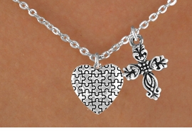 <bR>                EXCLUSIVELY OURS!!<Br>          AN ALLAN ROBIN DESIGN!!<BR>               LEAD & NICKEL FREE!!<BR>        W16019N - ELEGANT CROSS<Br>      & AUTISM AWARENESS HEART<Br>            NECKLACE ©2010 FROM<bR>                      $4.85 TO $8.50