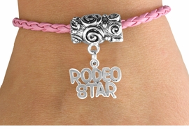 "<bR>               EXCLUSIVELY OURS!!<Br>         AN ALLAN ROBIN DESIGN!!<Br>              LEAD & NICKEL FREE!!<Br>W16134B - ""RODEO STAR"" CHARM<Br> PINK BRAIDED TOGGLE BRACELET<Br>              FROM $3.94 TO $8.75"