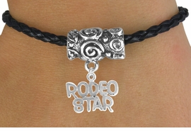 "<bR>                  EXCLUSIVELY OURS!!<Br>            AN ALLAN ROBIN DESIGN!!<Br>                 LEAD & NICKEL FREE!!<Br>W16140B - ""RODEO STAR"" CHARM &<Br>  BLACK BRAIDED TOGGLE BRACELET<Br>                 FROM $3.94 TO $8.75"